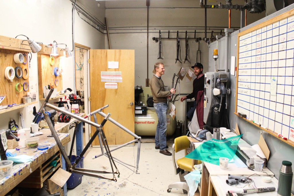 A door in the shop opens to the paint area, aka Coat, where finished frames are given candy coatings in any hue that clients request. Peder and Tom in the background are discussing Peder's Vanilla touring bike, which is about a month away from completion and about to get it's paint.