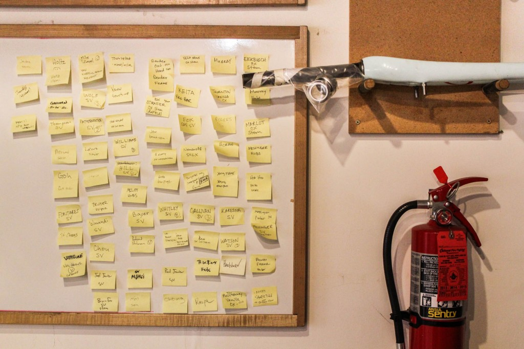 Each frame is tracked through completion on this whiteboard.